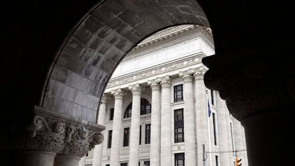 The State Education Building is seen through an archway