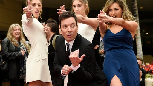 Jimmy Fallon, host of the 74th Annual Golden Globe Awards, poses with Miss Golden Globes 2017, from left, sisters Sistine, Scarlet and Sophia Stallone after rolling out the red carpet during Golden Globe Awards Preview Day at the Beverly Hilton on Wednesday, Jan. 4, 2017, in Beverly Hills, Calif. The awards will be held on Sunday. (Photo by Chris Pizzello/Invision/AP)