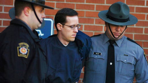 FILE - In this Jan. 5, 2015, file photo, Eric Frein is led away by Pennsylvania State Police Troopers at the Pike County Courthouse after his preliminary hearing in Milford, Pa.