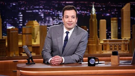 """Jimmy Fallon appears during his """"The Tonight Show"""" debut, in New York. Fallon is visiting the Sunshine State for his first TV trip since taking over """"The Tonight Show."""" The NBC show originates this week from the Universal Orlando Resort, where Fallon and company will tape editions to air today through Thursday."""