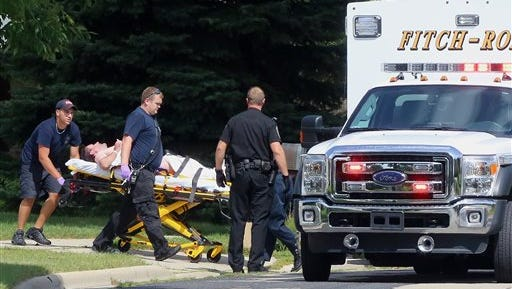 Emergency personnel transport Andy Steele, a recently retired Dane County sheriff's deputy, from his hom in Fitchburg, Wis. Authorities said Steele, 39, has been arrested in the fatal shooting of his wife, Ashlee Steele, 39, and sister-in-law, Kacee Tollesfsbol, 38, who were found shot dead in the Steele home. Charges are expected, according to police.