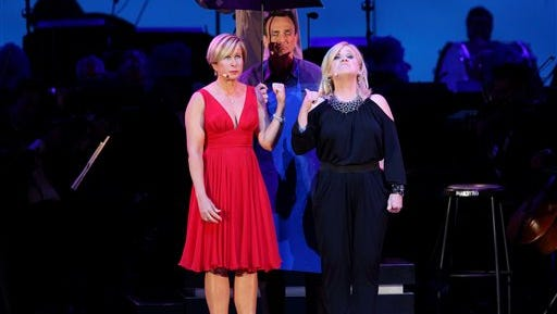 "In this photo provided by the Hollywood Bowl, Yeardley Smith, Hank Azaria and Nancy Cartwright perform at the world premiere of ""The Simpsons Take the Bowl"" at the legendary concert venue Friday in Los Angeles. The program featured music, stars and reminiscences from TV's longest-running scripted show."