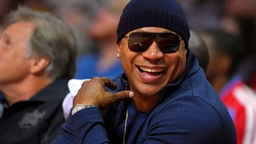 Rapper/actor LL Cool J watches the Los Angeles Clippers play the Utah Jazz during the first half of an NBA basketball game, Monday in Los Angeles.
