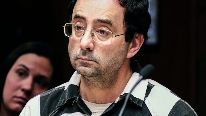 Larry Nassar listens to testimony of a witness during a preliminary hearing, in Lansing, Mich., Feb. 17, 2017. The former Michigan State University and USA Gymnastics doctor is accused of molesting girls at his home and a campus clinic.