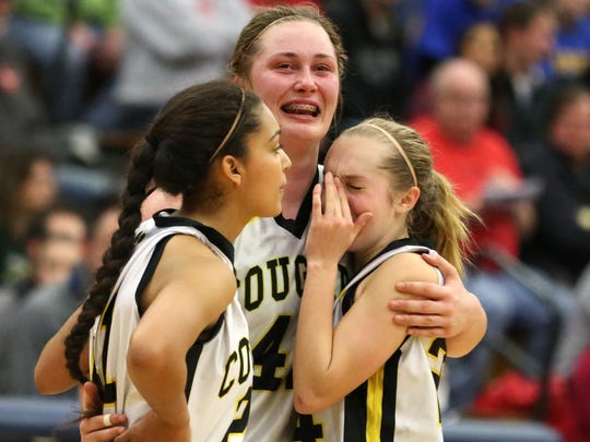 Cascade's Alyssa St. Peter, left, Halle Wright and Chrystal Wilson console each other as the Cougars fall to Sutherlin 45-40 in the Class 4A State Championship on Saturday, March 12, 2016, at Liberty High School in Hillsboro.