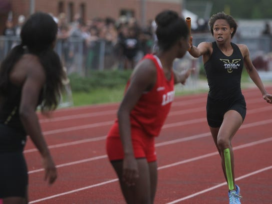 Lincoln's Yasmin Grace looks to make a baton pass during