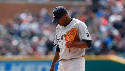 New York Yankees pitcher Luis Severino pauses against the Detroit Tigers in the first inning of a baseball game, Friday, April 8, 2016, in Detroit. Detroit won 4-0.
