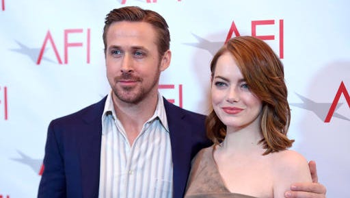 Ryan Gosling, left, and Emma Stone arrive at the AFI Awards at the Four Seasons Hotel on Friday, Jan. 6, 2017, in Los Angeles.