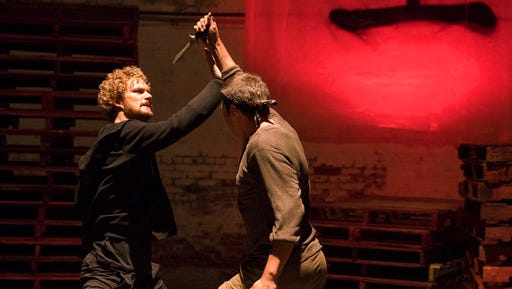 """This image released by Netflix shows Finn Jones, left, in a scene from the Netflix original series, """"Iron Fist."""" The series is and Netflix's fourth Marvel project, after """"Daredevil,"""" """"Jessica Jones"""" and """"Luke Cage."""""""