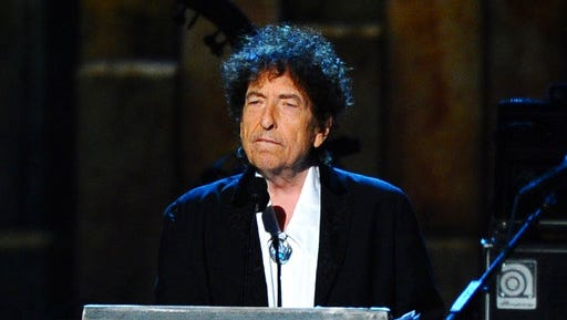 FILE - In this Feb. 6, 2015 file photo, Bob Dylan accepts the 2015 MusiCares Person of the Year award at the 2015 MusiCares Person of the Year show in Los Angeles. In a rare and lengthy interview, Dylan opened about his music and songwriting, and discussed about his relationships with Frank Sinatra, Elvis Presley and more icons. The Q&A with author Bill Flanagan was posted to Dylan's website on Wednesday, March 22, 2017.