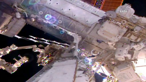 This still image taken from live video provided by NASA shows astronaut Shane Kimbrough, right, works on the International Space Station during a space walk on Friday, March 24, 2017.    Kimbrough and France's Thomas Pesquet emerged early from the orbiting complex, then went their separate ways to accomplish as much as possible 250 miles up. Their main job involves disconnecting an old docking port. This port needs to be moved in order to make room for a docking device compatible with future commercial crew capsules.