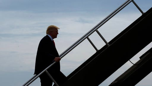 President Donald Trump walks up the steps of Air Force One at General Mitchell International Airport in Milwaukee, Tuesday, April 18, 2017. Trump went to Kenosha, Wis., to visit the headquarters of tool manufacturer Snap-on Inc., and sign an executive order that seeks to make changes to a visa program that brings in high-skilled workers.