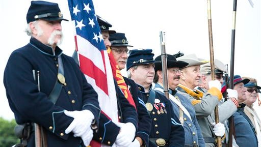 A group of reenactors portraying Union and Confederate soldiers stand during the opening ceremony commemorating the 150th anniversary of the Battle of Monocacy, the only major Confederate victory on northern soil, Wednesday  at the Monocacy National Battlefield near Fredrick, Md.