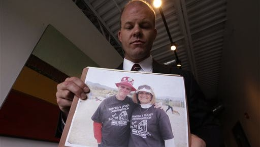 Attorney Paxton Guymon holds a photograph of Jim and Jan Harding following a news conference Thursday in Salt Lake City. Jan Harding, 67, drank sweet tea containing a toxic cleaning chemical, severely burning her mouth and throat at a Utah restaurant after an employee mistook the substance for sugar and mixed it into a dispenser. Harding is listed in good condition at a Salt Lake City hospital as she continues to improve. Authorities say a worker at Dickey's Barbecue in South Jordan unintentionally put the chemical cleaning compound in a sugar bag last month.