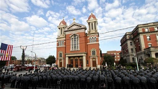 Pennsylvania State Troopers fill the 300 block of Wyoming Ave in Scranton for the start of Pennsylvania State Police Cpl. Bryon K. Dickson II's funeral at St. Peter?s Cathedral on Thursday in Scranton, Pa.