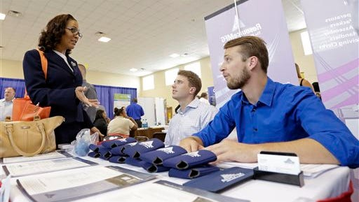 In this photo taken Wednesday, July 16, 2014, job seeker Staci Sudduth, left, talks to job recruiters Cameron Quin, center, and Jay Kington, right, at a Hiring Fair For Veterans in Fort Lauderdale, Fla. Payroll processer ADP says private employers added 218,000 jobs last month, down from 281,000 in June. It was the fourth straight month of job gains above 200,000, a healthy pace that usually is enough to lower the unemployment rate.