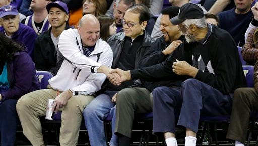 """FILE - In this Jan. 25, 2014, photo, then-Microsoft CEO Steve Ballmer, left, shakes hands with former NBA players Bill Russell, right, and """"Downtown"""" Freddie Brown as Omar Lee looks on during an NCAA college basketball game between Washington and Oregon State in Seattle. An individual with knowledge of negotiations to sell the Los Angeles Clippers said Shelly Sterling has reached an agreement to sell the team to Ballmer for $2 billion. The individual, who wasn?t authorized to speak publicly, told The Associated Press on Thursday, May 29, 2014, that Ballmer and the Sterling Family Trust now have a binding agreement. The deal now must be presented to the NBA."""