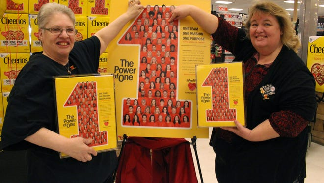 ShopRite of Fishkill employees Rose Marie Khuns of Hopewell Junction, left, and Dawn Doughty-Myers of Poughkeepsie, point to their photos on a special edition Cheerios box during an event at the store March 15.