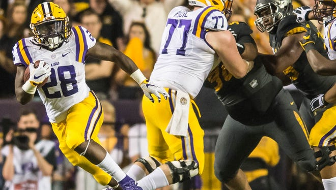 LSU Tigers running back Darrel Williams (28) looking for the running lane during the first half of a SEC game between Missouri and the LSU Tigers in Baton Rouge on Saturday October 1, 2016.