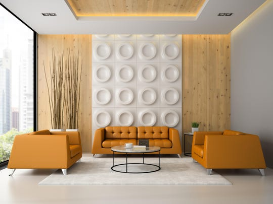 Interior of living room with orange armchairs and sofa
