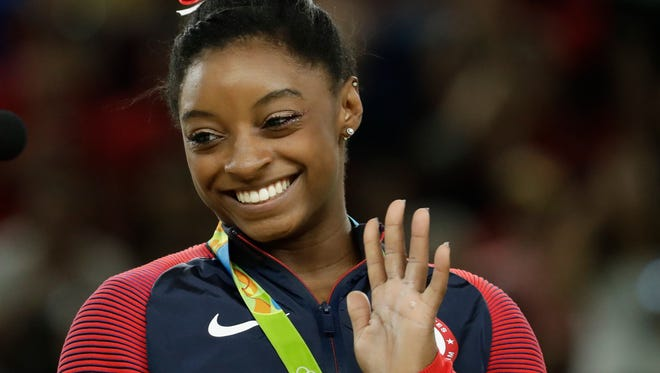 United States' Simone Biles celebrates on the podium after winning vault gold during the artistic gymnastics women's apparatus final Sunday.