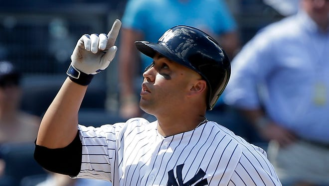 New York Yankees' Carlos Beltran reacts as he crosses the plate after hitting a three-run home run against the Colorado Rockies during the seventh inning of a baseball game, Wednesday, June 22, 2016, in New York.