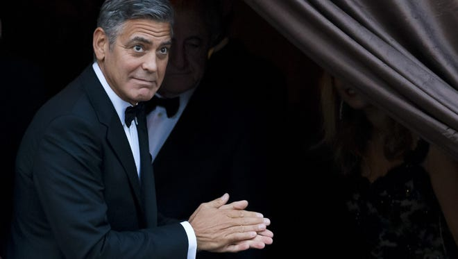 """FILE - In this Sept. 27, 2014 file photo, George Clooney arrives at the Aman hotel in Venice, Italy. Clooney made an appearance at New York Comic Con, Thursday, Oct. 9, 2014 for a panel on his upcoming film, """"Tomorrowland.""""  (AP Photo/Andrew Medichini)"""