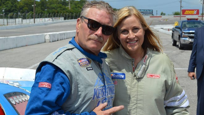 Track promoter Tony Formosa, left, with Mayor Megan Barry about to take ride around the track at Fairgrounds Speedway Nashville.