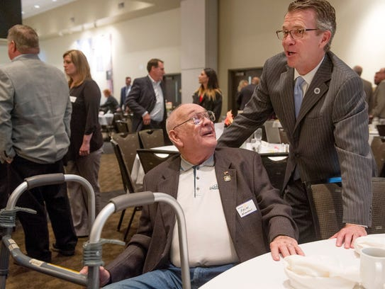 Evansville Mayor Lloyd Winnecke, right, visits with