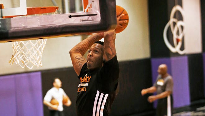 Former Arizona State guard Jahii Carson dunks during a workout for the Suns on Wednesday, May 28, 2014, at US Airways Center in Phoenix.