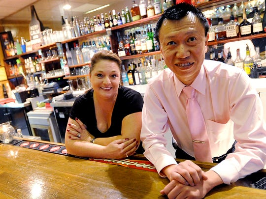 Kuan Lim (right) owns Lucky Palace in Bossier City