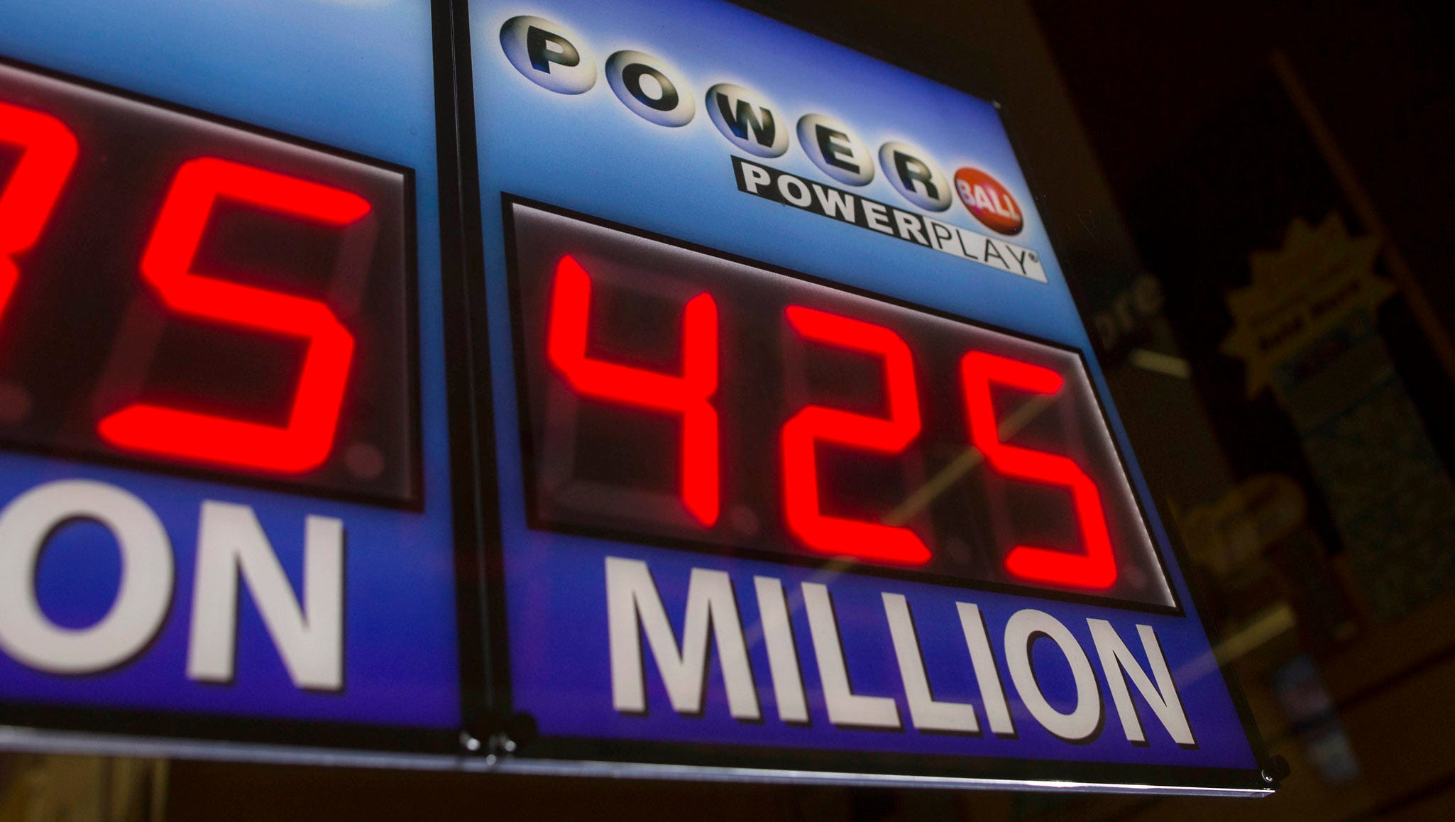 A sign shows the current Powerball jackpot at a convenience store in Chicago. The winning numbers will be drawn tonight.