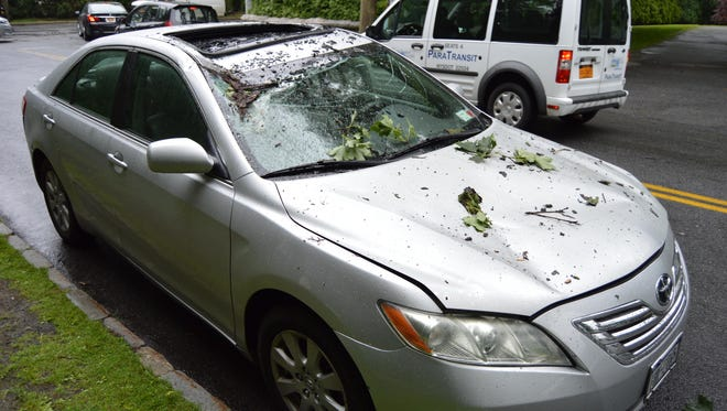 A tree fell on a car with passengers inside at the intersection of Weaver Street and Quaker Ridge Road in Scarsdale on Thursday. Nobody was injured in the incident.