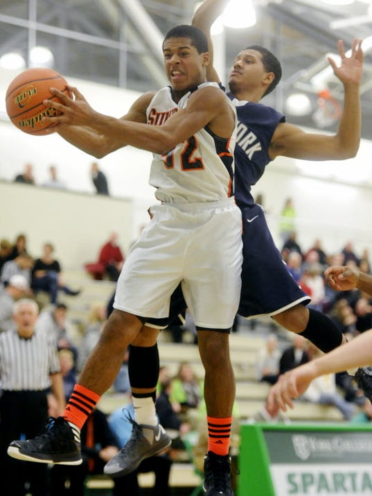 York Suburban's Manny McDowell gets the rebound against West York's Roque Lopez in the third quarter of the Donnie Swartz Memorial Classic doubleheader on Saturday, Jan. 12, 2013, at York College.(DAILY RECORD/SUNDAY NEWS - CHRIS DUNN)
