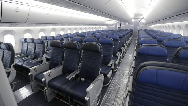 This Jan. 26, 2016, file photo, shows economy class seating on a new United Airlines Boeing 787-9 undergoing final configuration and maintenance work at Seattle-Tacoma International Airport in Seattle.