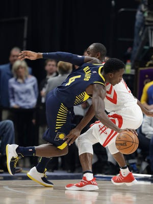 Indiana Pacers' Victor Oladipo (4) is defended by Houston Rockets' Luc Mbah a Moute during the first half of an NBA basketball game, Sunday, Nov. 12, 2017, in Indianapolis. (AP Photo/Darron Cummings)