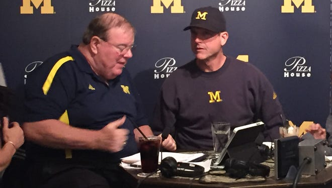 Michigan football coach Jim Harbaugh, right, and radio broadcaster Jim Brandstatter.