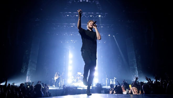Imagine Dragons performs for the crowd on Tuesday, June 23, 2015, at the Palace of Auburn Hills, MI.