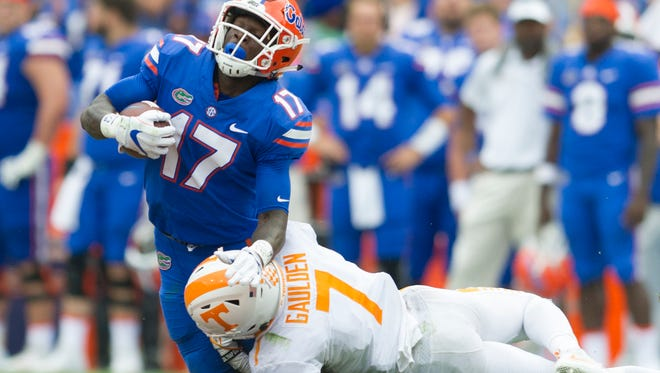 Florida defensive lineman Jordan Sherit (17) gets downed by Tennessee defensive back Rashaan Gaulden (7) during the Tennessee Volunteers vs. Florida Gators game at Ben Hill Griffin Stadium in Gainesville, Florida on Saturday, September 16, 2017.