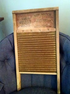 The washboard, needed nothing but a strong arm and lots of patience.