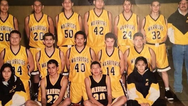Heart Butte Warriors, coached by Leo Kennerly, won the State C boys' basketball championship in 2000. Team members included, standing from left, Narsis Reevis, CJ Aimsback, Jess Rutherford, Mike Chavez, Kevin Calfrobe, Wayne Racine and coach Leo Kennerly. Kneeling, from left, are Jess Racine, Allen Running Crane, Aaron Horn, Kothan First Rider, and Gavin Aimsback. Sitting, from left, are Little Plume Murray and Nat Ironheart. The names of the student managers were not available.
