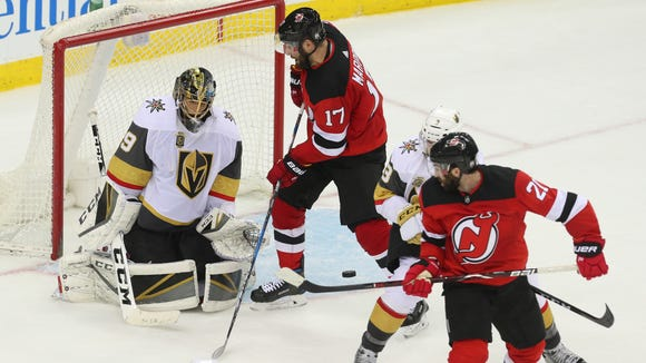 New Jersey Devils right wing Kyle Palmieri (21) tips the puck wide of the goal against Vegas Golden Knights goaltender Marc-Andre Fleury (29) during the third period at Prudential Center.
