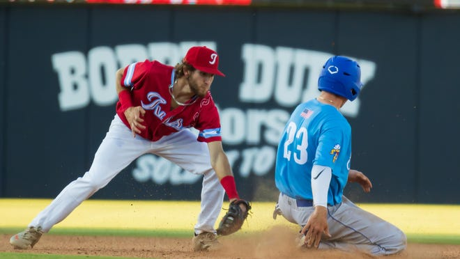 Amarillo Sod Dogs Rhett Maynard (right) steals second as Tulsa Drillers shortstop Hueston Morrill covers the bag in Tuesday night's game at Hodgetown. The Sod Dogs won the series opener 4-3.
