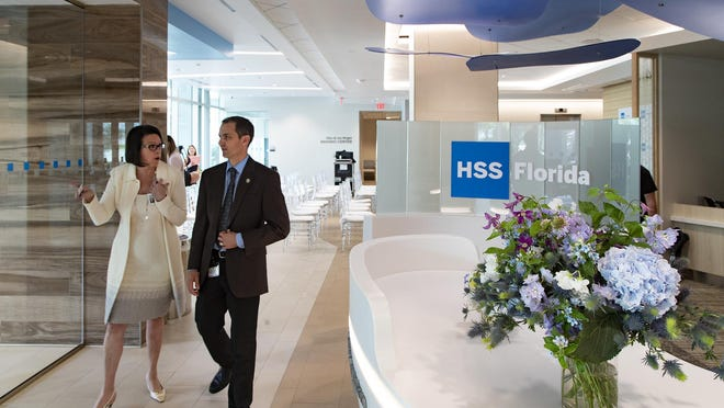 Rena Courtay, Vice President, Executive Director HSS Florida gives a tour of the new Hospital for Special Surgery to Christopher Roog, director of economic development for the City of West Palm Beach.