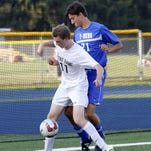 Notre Dame's Rocco Coulibaly (7) controls the ball as Max Westwater of Trumansburg defends Thursday in boys soccer at Brewer Memorial Stadium.