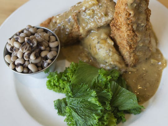 "The ""Kentucky Fried Freedom,"" a plate of battered and fried seitan is served with gravy and black eyed peas at Tasty Harmony on Thursday, June 22, 2017. The vegetarian and vegan restaurant is located at 160 W. Oak Street in Old Town."