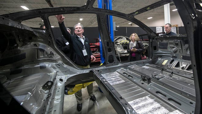 Munro & Associates CEO Sandy Munro discusses design flaws he has found with the body of a Tesla Model 3 that was part of a reverse engineering event at Munro & Associates in Auburn Hills on Wednesday April 25, 2018.