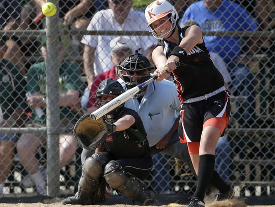 Kaukauna's Haley Hestekin connects with a pitch against