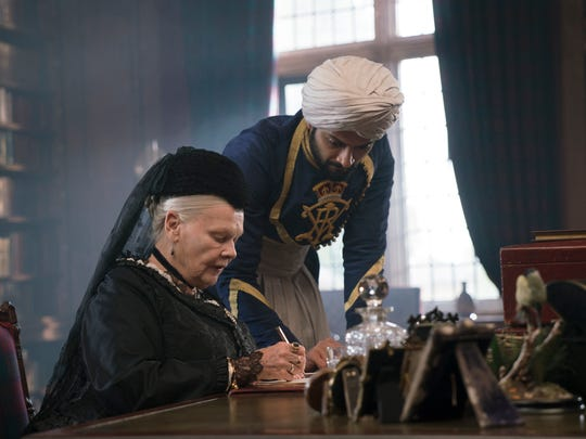 """Queen Victoria (Judi Dench, left) receives counsel from Abdul Karim (Ali Fazal), an Indian clerk who becomes the queen's confidant in """"Victoria & Abdul."""""""