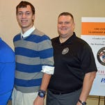 Covington Catholic students Chris Holthaus, left, and David Rice attended the West Point Leadership and Ethics Seminar with teacher Andy Zerhusen, right.